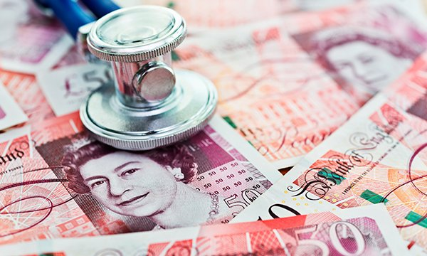 stethoscope and cash in sterling