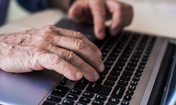 hand on a laptop keyboard