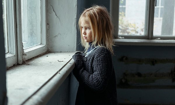 child looks out of window
