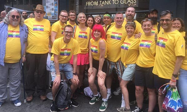 Drew Payne in blue shirt with colleagues from Whittington Health at London Pride