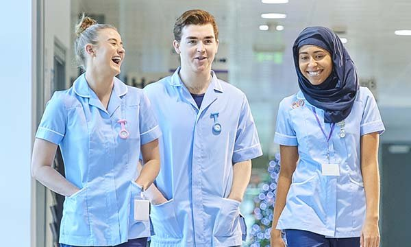 Three nursing students look happy to be on clinical placement together