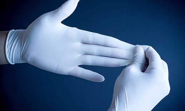 Removing plastic gloves from hands