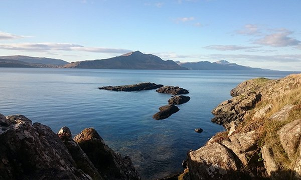 view of sea and mountains from the Scottish island of Rassay, where resident nurses have been appointed after a 10-year absence