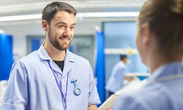 Male nurse being kind to a colleague