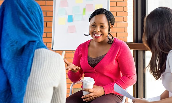 women smile and talk together