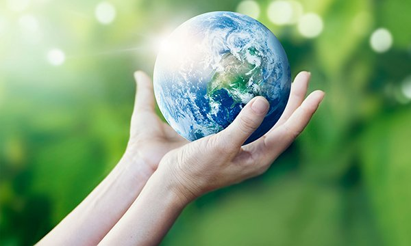 Hands hold a globe representing planet earth