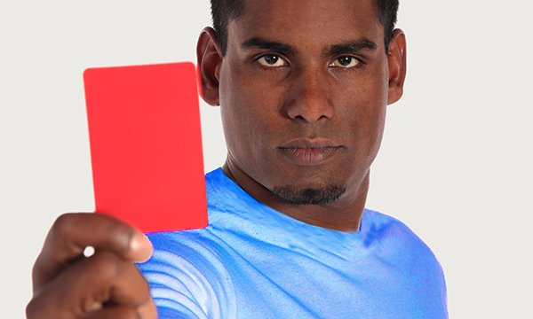 Man holding red card up