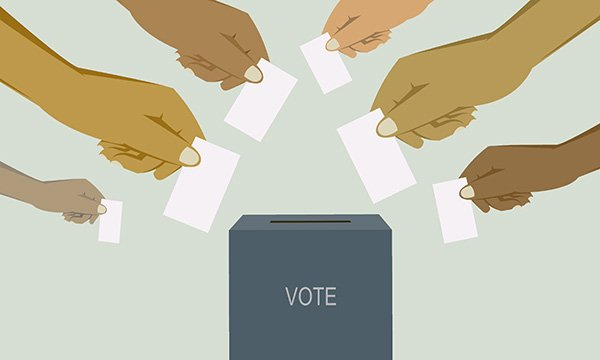 illustration shows hands posting ballot papers into a ballot box as Northern Ireland RCN members prepare to vote on whether to take industrial action