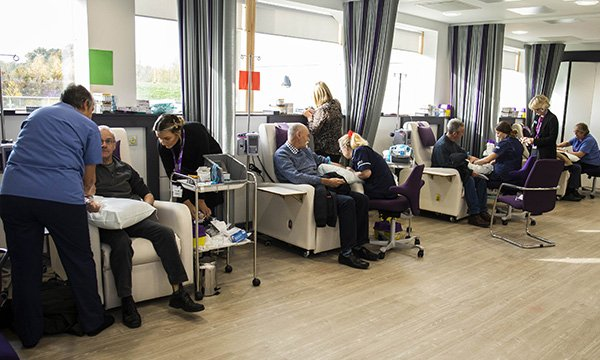 Picture shows men sitting in a row of chairs receiving free blood tests to check their PSA (prostate specific antigen) levels to screen for prostate cancer. More than 2,000 men received the test in a weekend event run by a volunteer group in Reading.