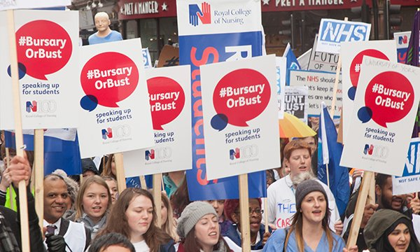 RCN activists protest against the removal of the nursing bursary. They are holding banners saying '#BursaryorBust'