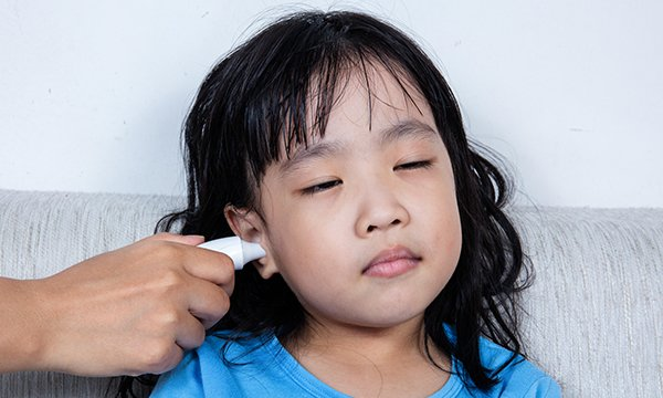 Girl having temperature taken