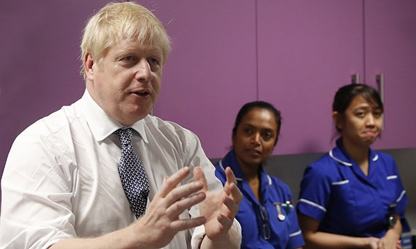 Prime minister Boris Johnson talking to nurses during 2019 election campaign