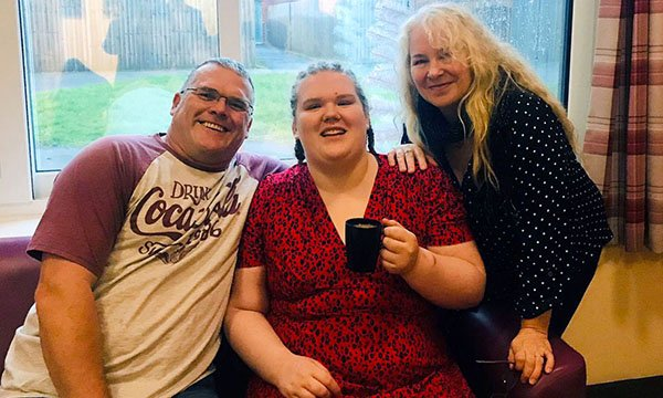 Image shows service user Bethany with her father and mother