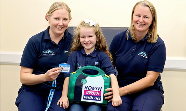 Picture of Nahla Walker (centre), with nurses Helen Drury (left) and Joanne Leivesley. When Nahla, aged six, told them she wanted to be a nurse, they ordered a special outfit for her with the name badge 'Nurse in training'.