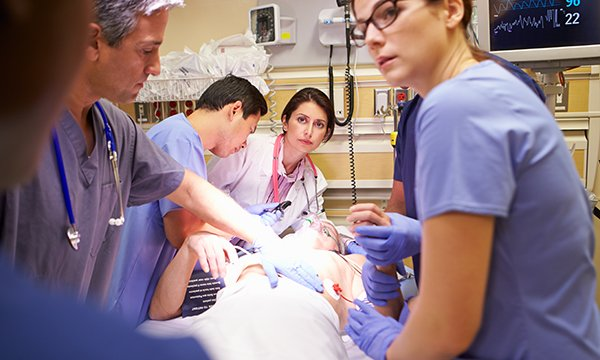 clinical team works on a patient