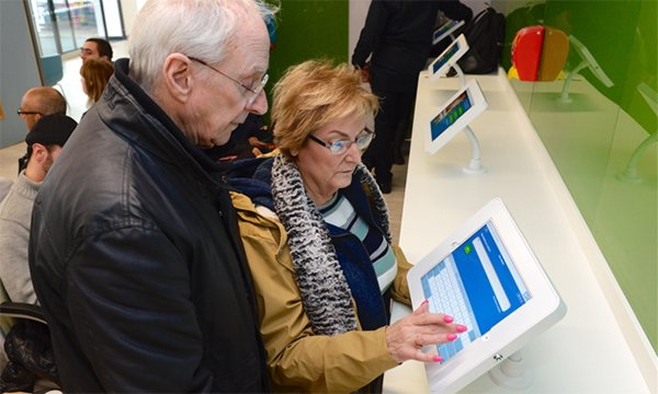 Patients checking in using the eTriage tablet