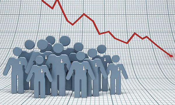 Picture shows a group of abstract figures representing nurses against a background of a falling graph