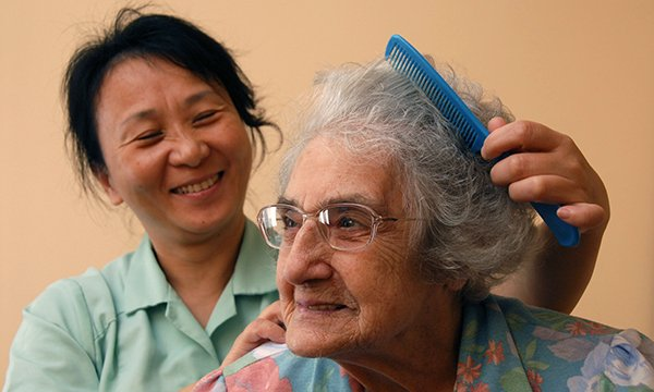 Overseas nursing healthcare assistant working in a care home in the UK