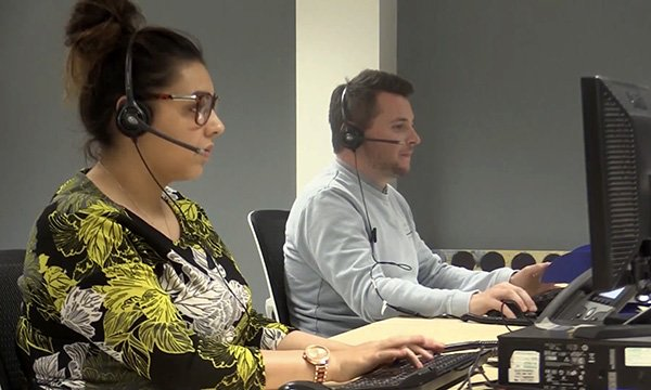 Picture shows peple weating headsets taking calls at the Greater Manchester Resilience Hub, set up after the 2017 attack