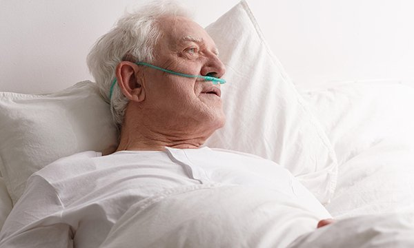 male in-patient lies in bed