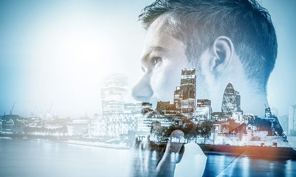 A young man's face superimposed over the London skyline