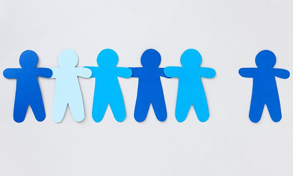 A blue paper doll chain with one figure missing