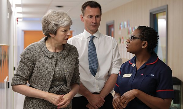 Prime minister Theresa May and health secretary Jeremy Hunt at a hospital with a nurse