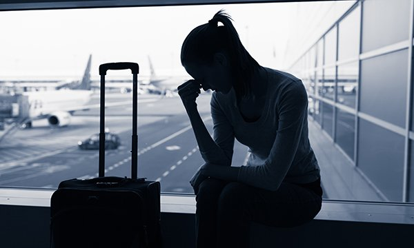 woman looks dejected at airport