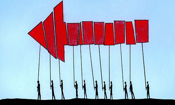 Illustration depicting a line of figures carrying placards which together form a large  arrow pointing forward. In this article senior nurses discuss how to remove the culture of fear and create a compassionate workplace in which everyone feels valued.