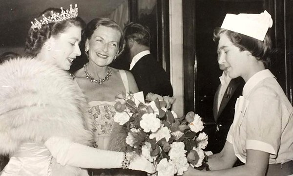 Jean Higgins presents a bouquet to the then Princess Elizabeth, now the Queen at a film premiere