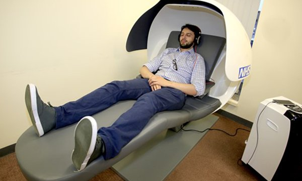 A junior doctor trying out a sleep pod