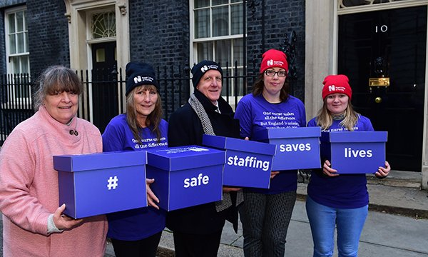 Danielle Tiplady, patients and RCN members hold boxes containing their safe staffing petitions in Downing Street