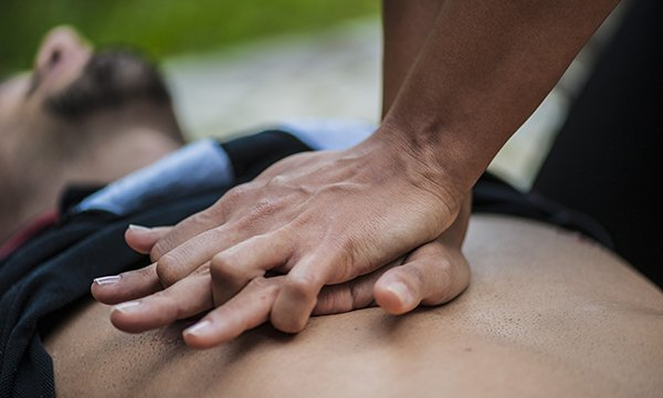 Someone performing CPR on another person. The RCN says guidance on CPR will be updated to give nurses clearer direction