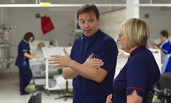 Picture shows medics having a conversation in a hospital ward. A new handbook reflects the expanded role of the modern matron and can be a guide for training and continuing professional development.
