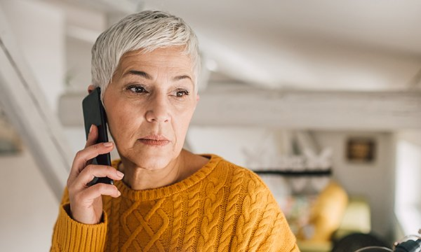 A woman holding a phone. Many woman experiencing breast cancer fear they are missing life extending treatment. Picture: iStock