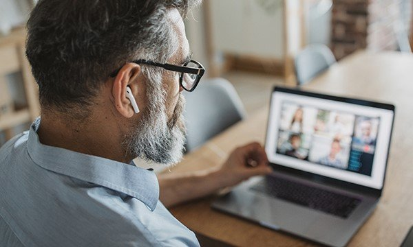 A man looking at a video conference meeting on his computer screen. The COVID-19 pandemic has meant hearings have been held virtually. Picture: iStock