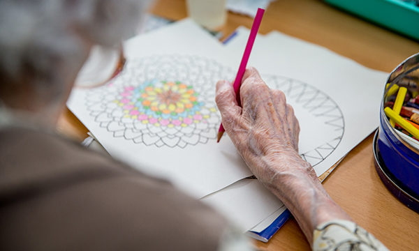 person doing an colouring activity