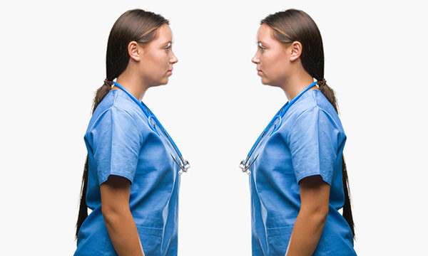 identical nurses face each other