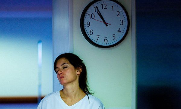 Picture shows a model posing as a tired nurse in a hospital at night. Pressures facing nursing remain a particular concern and the health service is relying on unpaid overtime and the goodwill of the wider workforce, a report says.