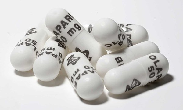 Picture shows olaparib capsules. Olaparib inhibits enzymes that repair DNA in cancer cells.