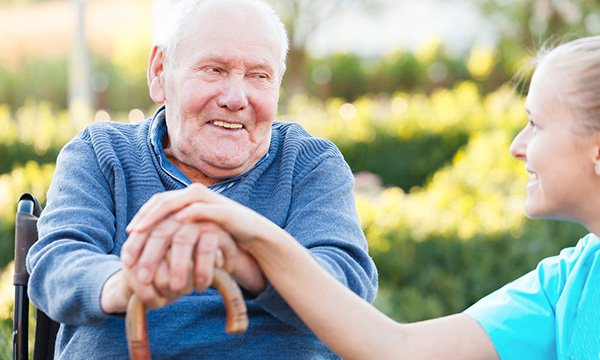 Older man with walking stick and nurse. Picture: iStock