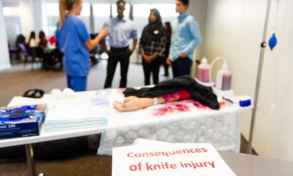 Image shows emergency nurse training students to treat young people affected by knife wounds
