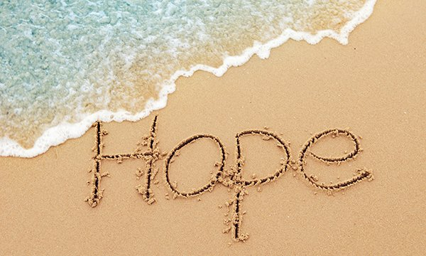 The word 'Hope' written in sand on a beach. Picture: iStock
