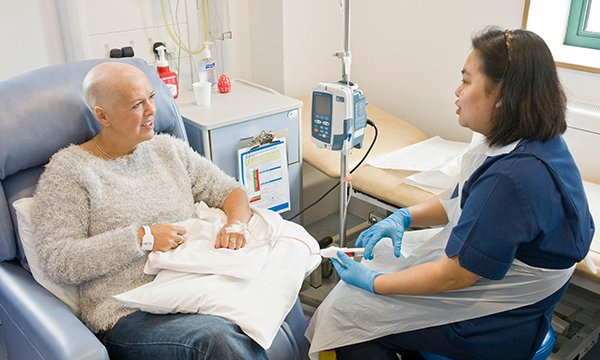 Nurse talking to a patient with cancer