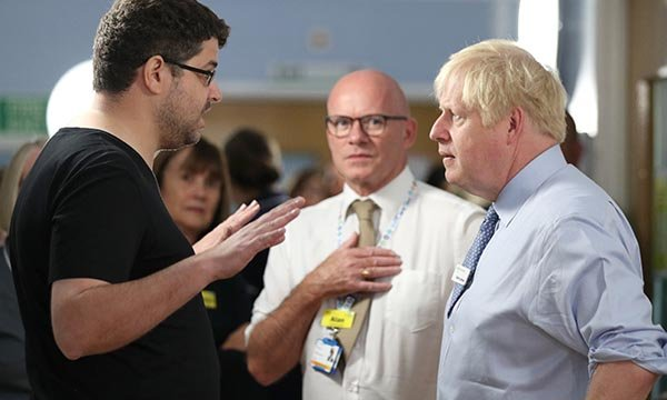 Omar Salem (left) confronts Boris Johnson as Alan Gurney (centre) looks on Picture: PA