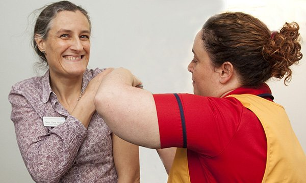 NHS staff member receives her flu jab