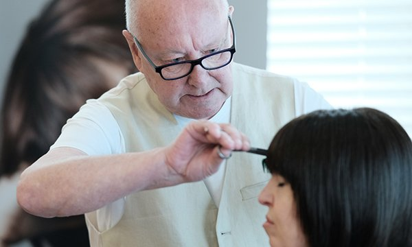 Picture shows celebrity hairdresser Trevor Sorbie styling a wig. People devastated by losing their hair due to chemotherapy are being helped by his charity, which trains hairdressers to customise their wigs.