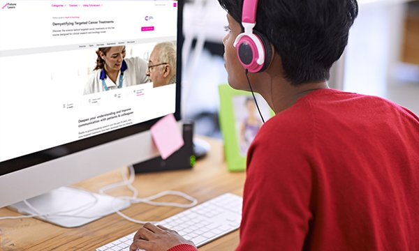Picture shows a woman wearing headphones sitting in front of a computer screen. Nurses can take a free online course on targeted cancer treatments. Launching in February, it comprises two to three hours of learning per week for five weeks.