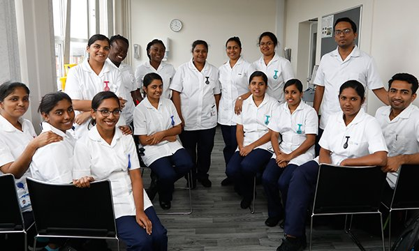 A group of overseas-trained nurses at Salford Royal NHS Trust in 2019