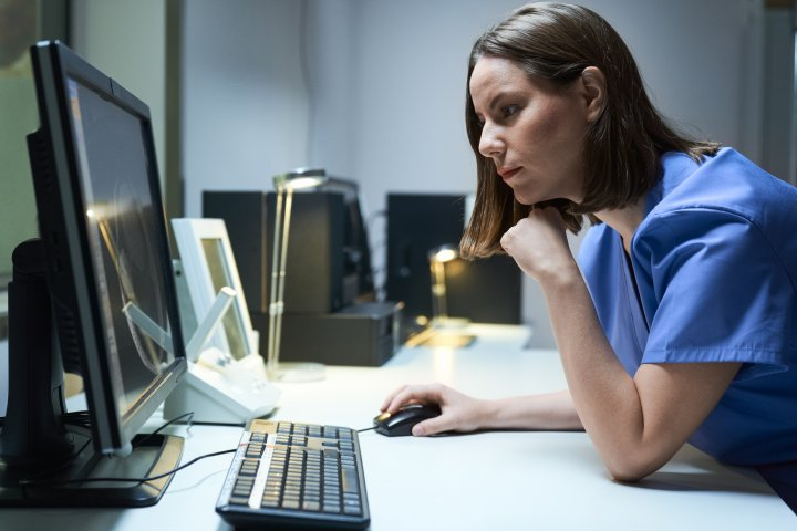 Nurse accessing patient records on a computer